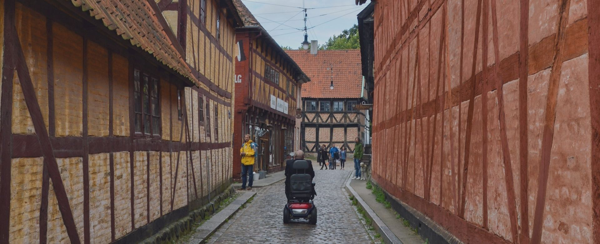 A man in a power wheelchair showing how accessible travel is done in Aarhus, Denmark